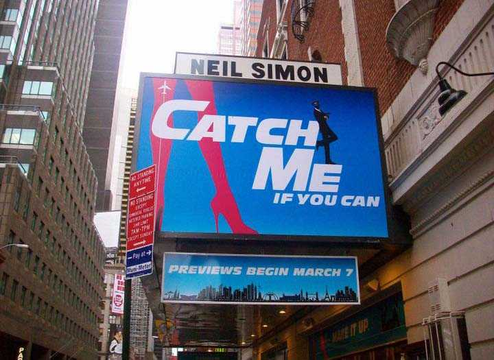 Neil Simon Theatre on Broadway with billboard of musical 'Catch Me If You Can'